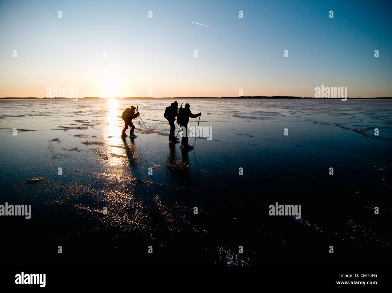 Long-distance skaters against clear sky - Stock Image