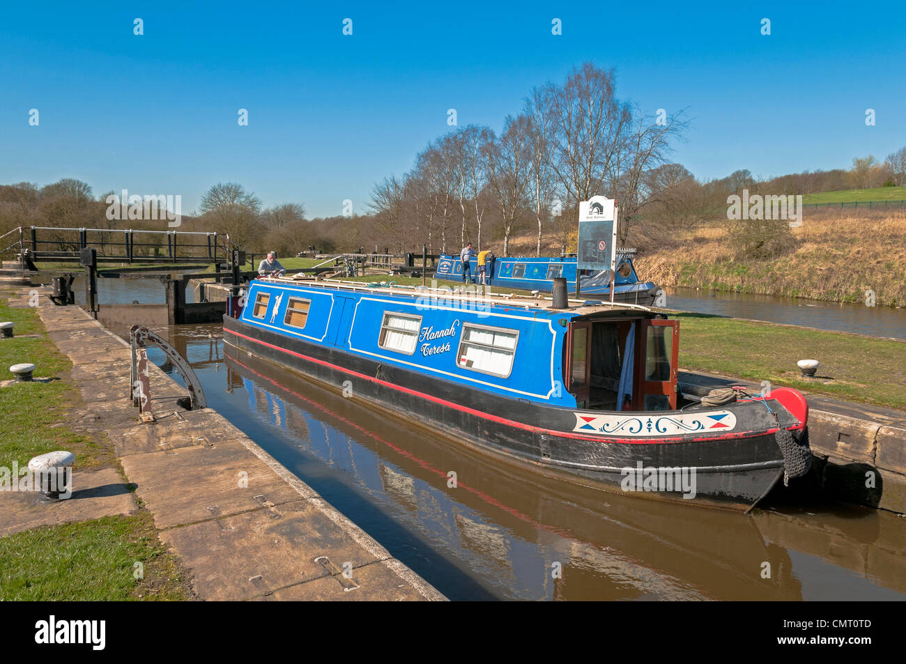 Canal narrowboat at Dean lock at Gathurst on the Leeds Liverpool canal. - Stock Image