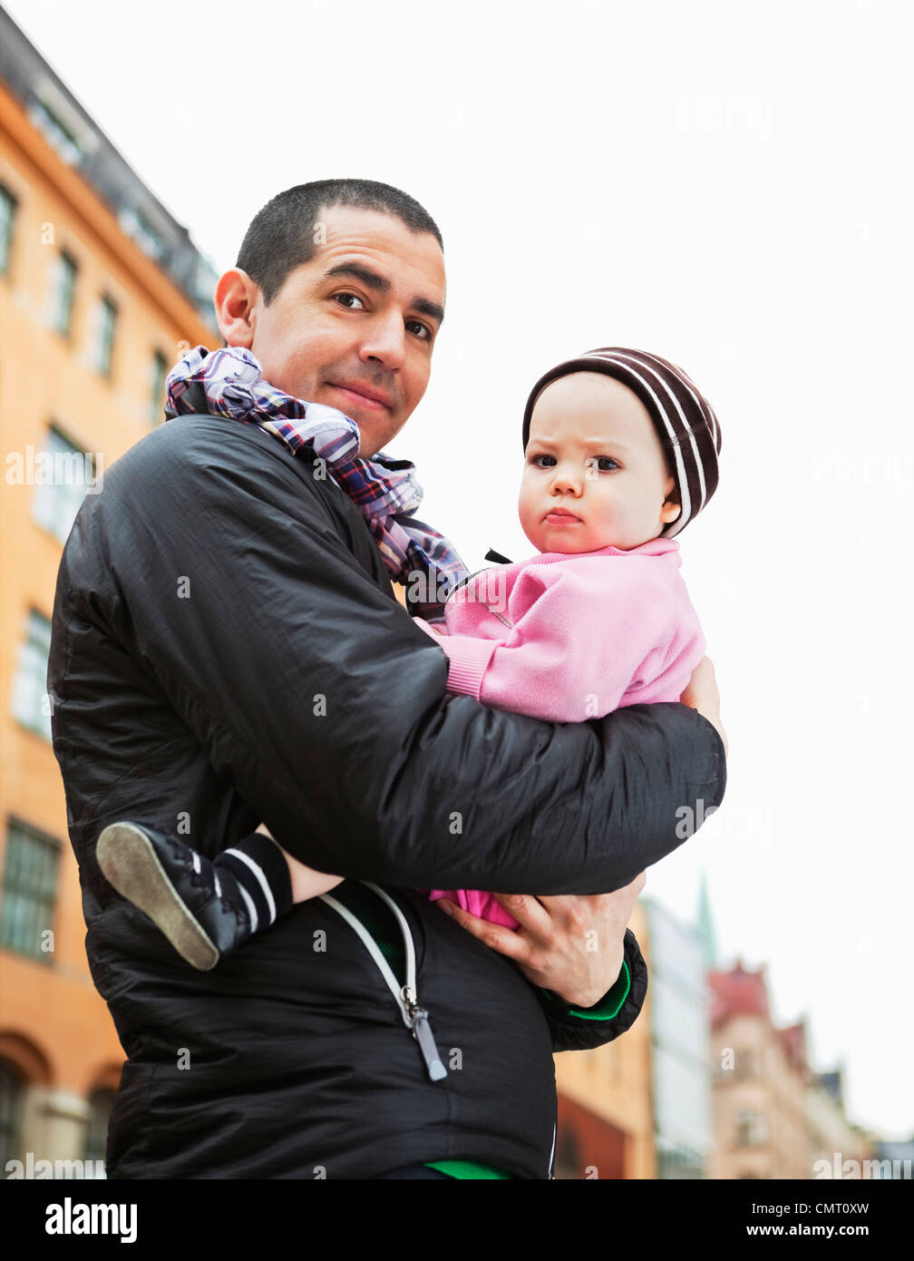 Father holding his daughter (0-11 months) - Stock Image