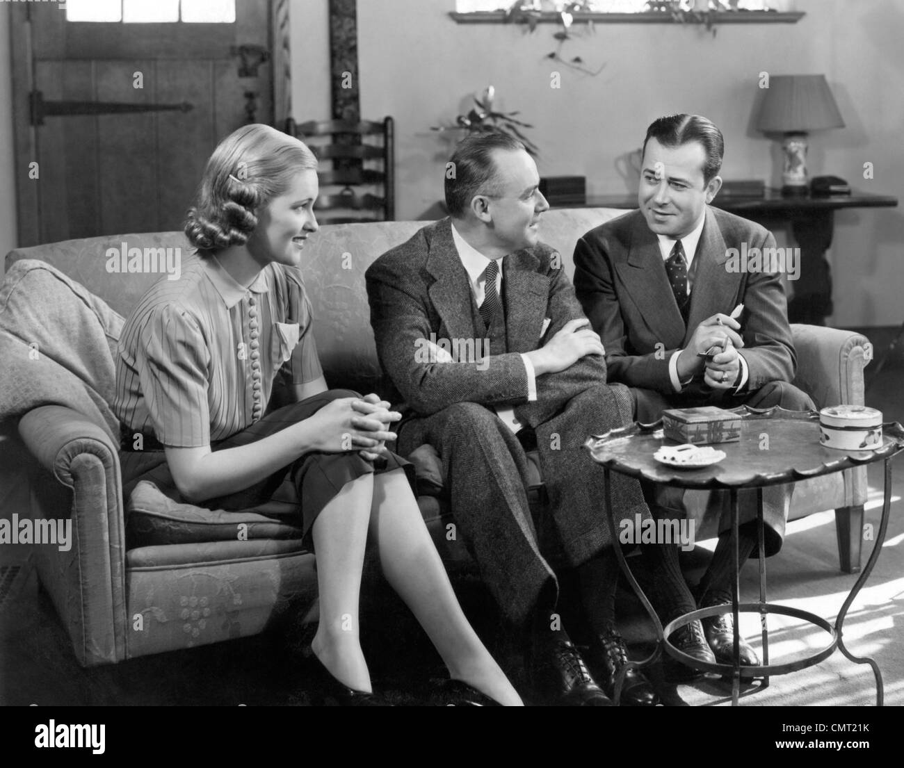 Wondrous 1930S 1940S Two Men And Woman Social Group Sitting On Couch Gmtry Best Dining Table And Chair Ideas Images Gmtryco
