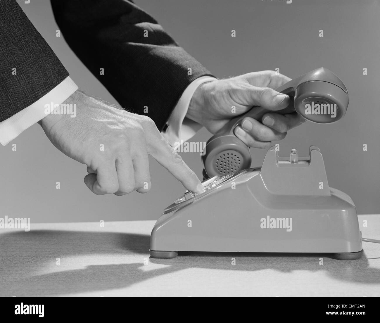 1960s MALE HANDS DIALING  ROTARY TELEPHONE - Stock Image