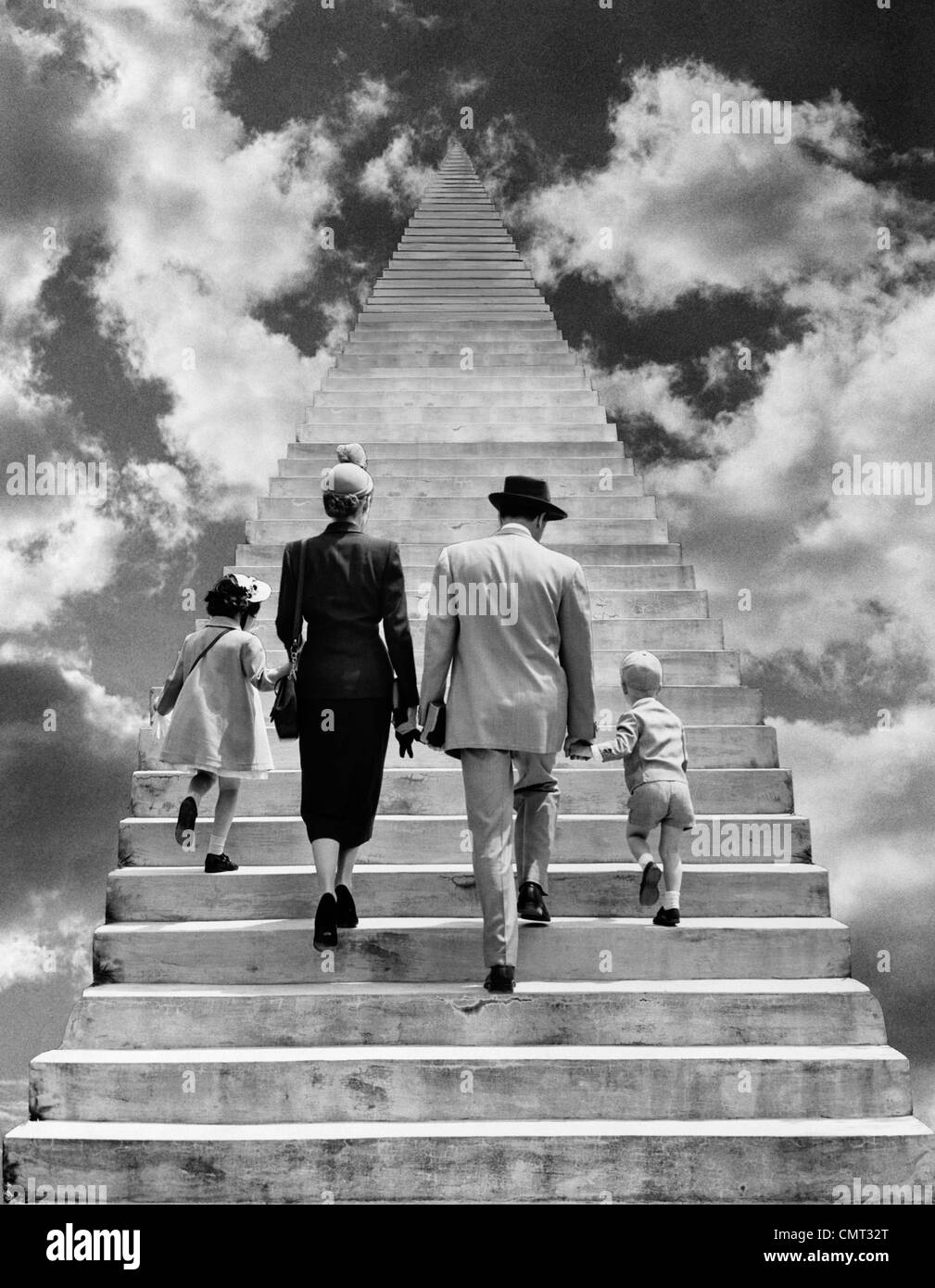 1950s BACK VIEW MONTAGE FAMILY FATHER MOTHER DAUGHTER SON WALKING UP STAIRWAY TOGETHER INTO THE SKY SYMBOLIC - Stock Image
