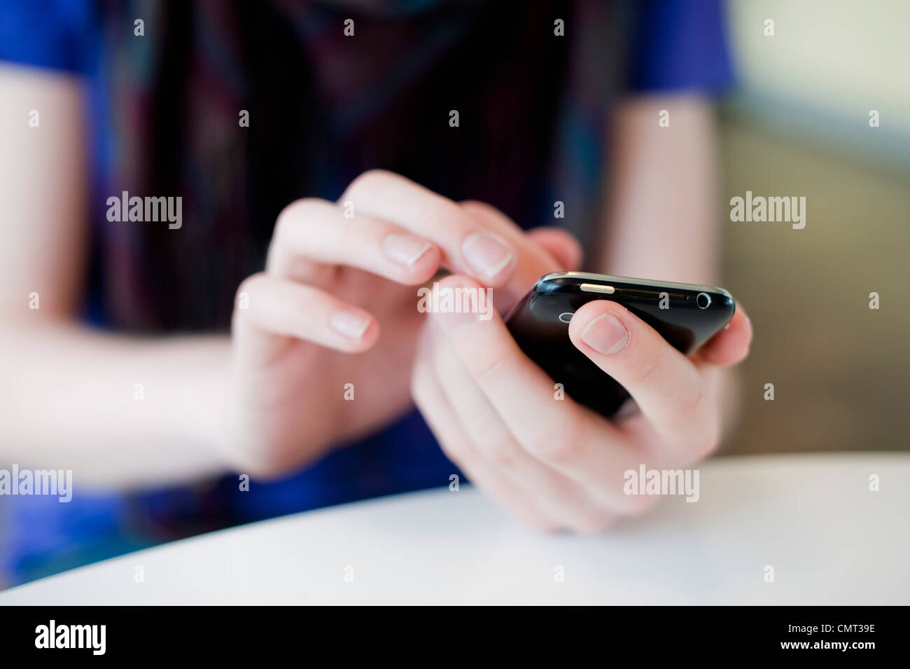 Close-up of human hands holding mobile phone - Stock Image