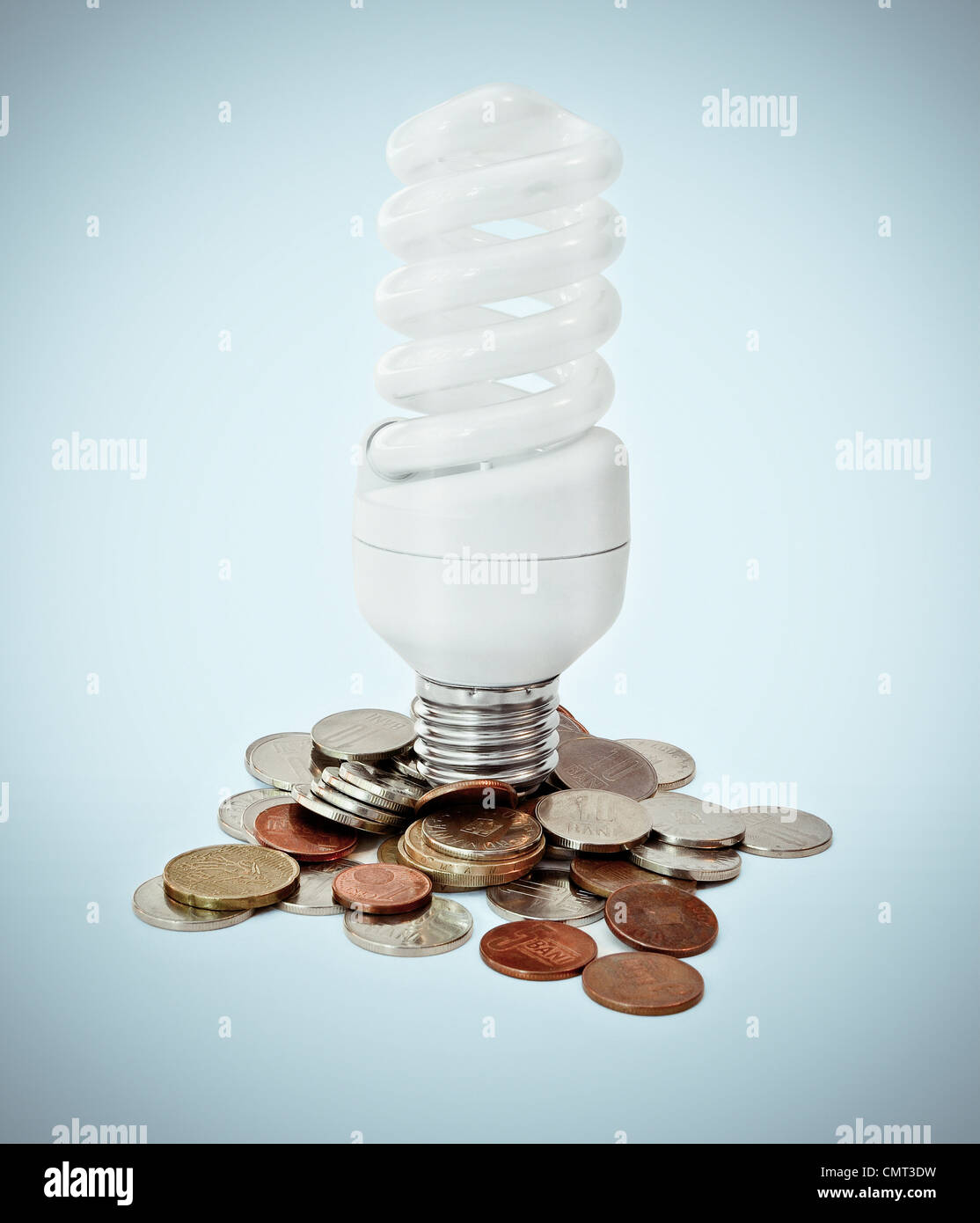 Eco lighbulb concept and money savings on energy - Stock Image