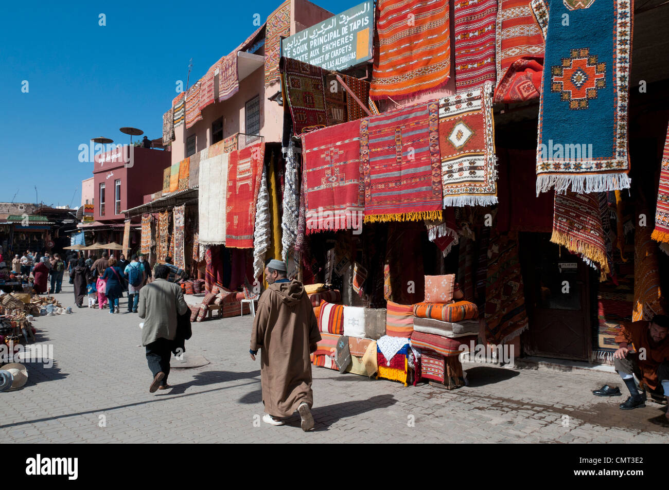 Marrakech, Morocco - Street scene in the busy souk market at Rahba Qedima in Medina district, Marrakech, North Africa - Stock Image