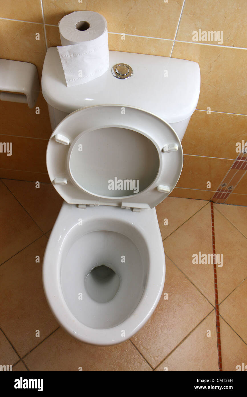 Top view of a white, porcelain toilet bowl. - Stock Image