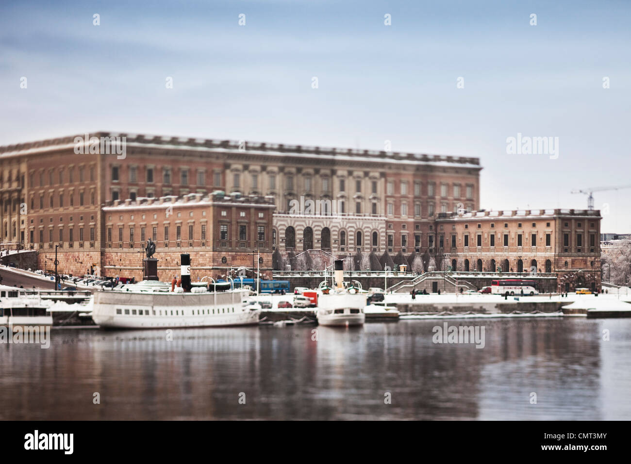 Beautiful view of Stockholm Royal Palace and nautical vessel against clear sky - Stock Image