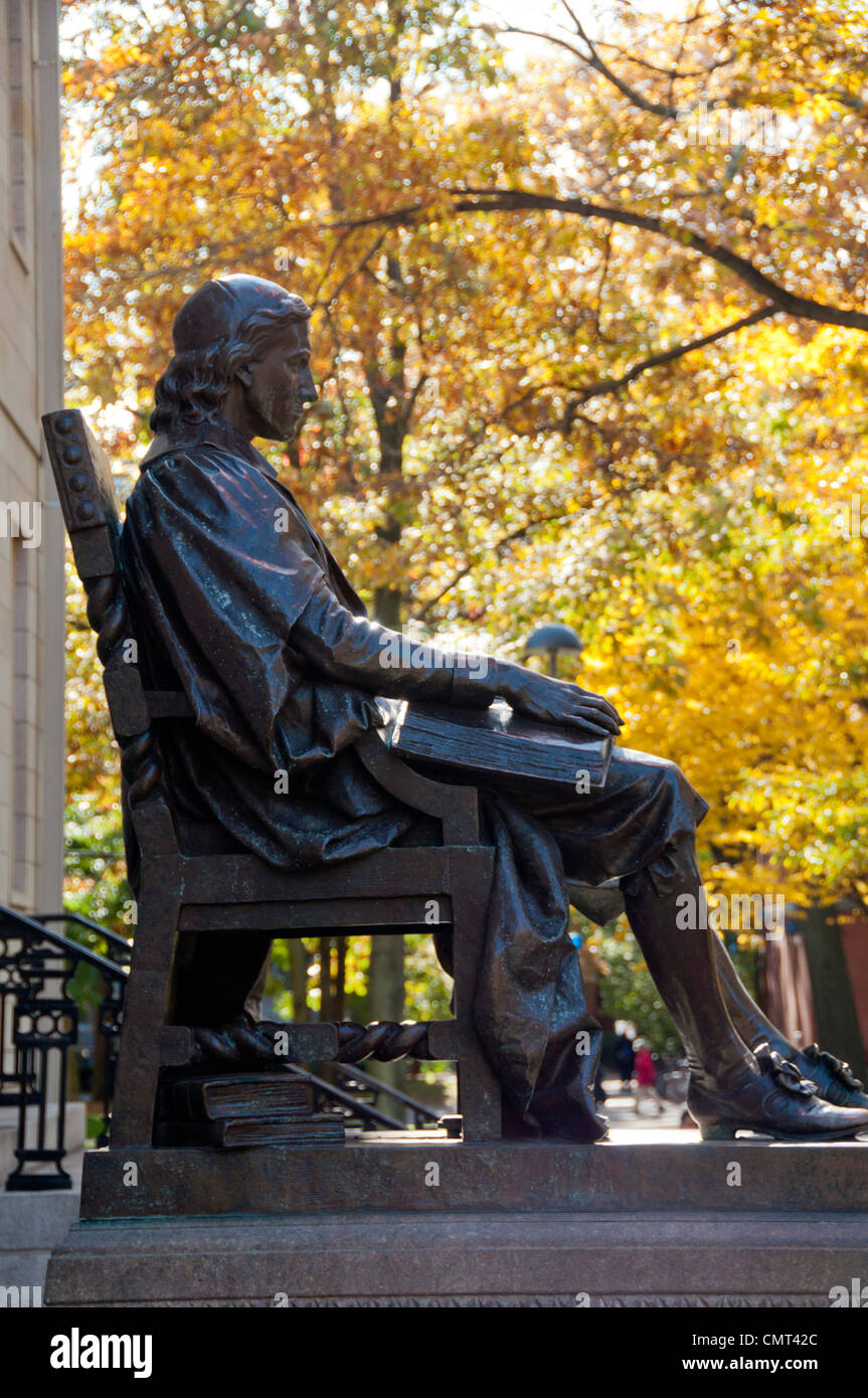 John Harvard statue on campus at Harvard University, Cambridge, Massachusetts, USA - Stock Image
