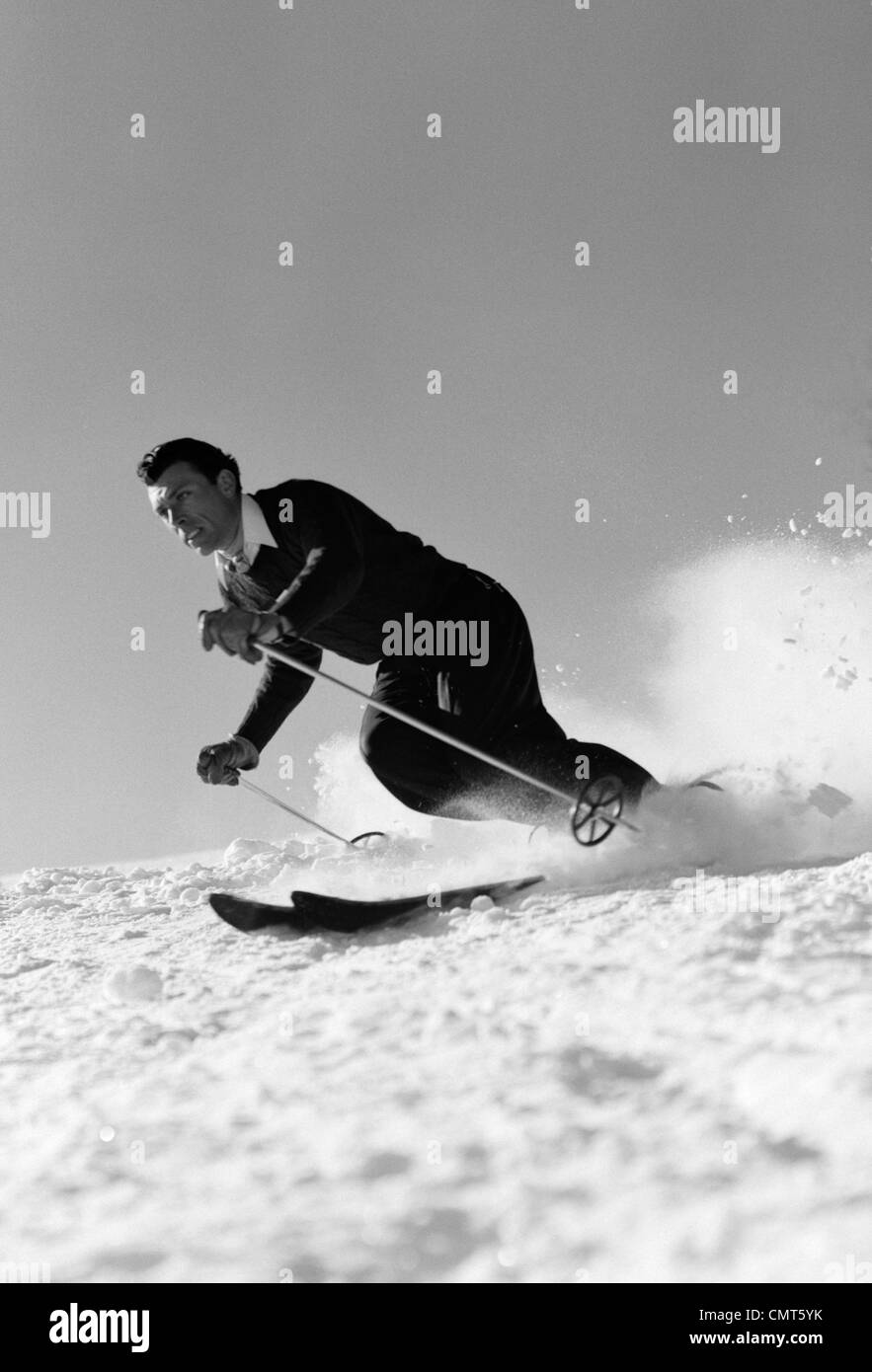 1940s MAN DOWNHILL SKIING WINTER OUTDOOR Stock Photo