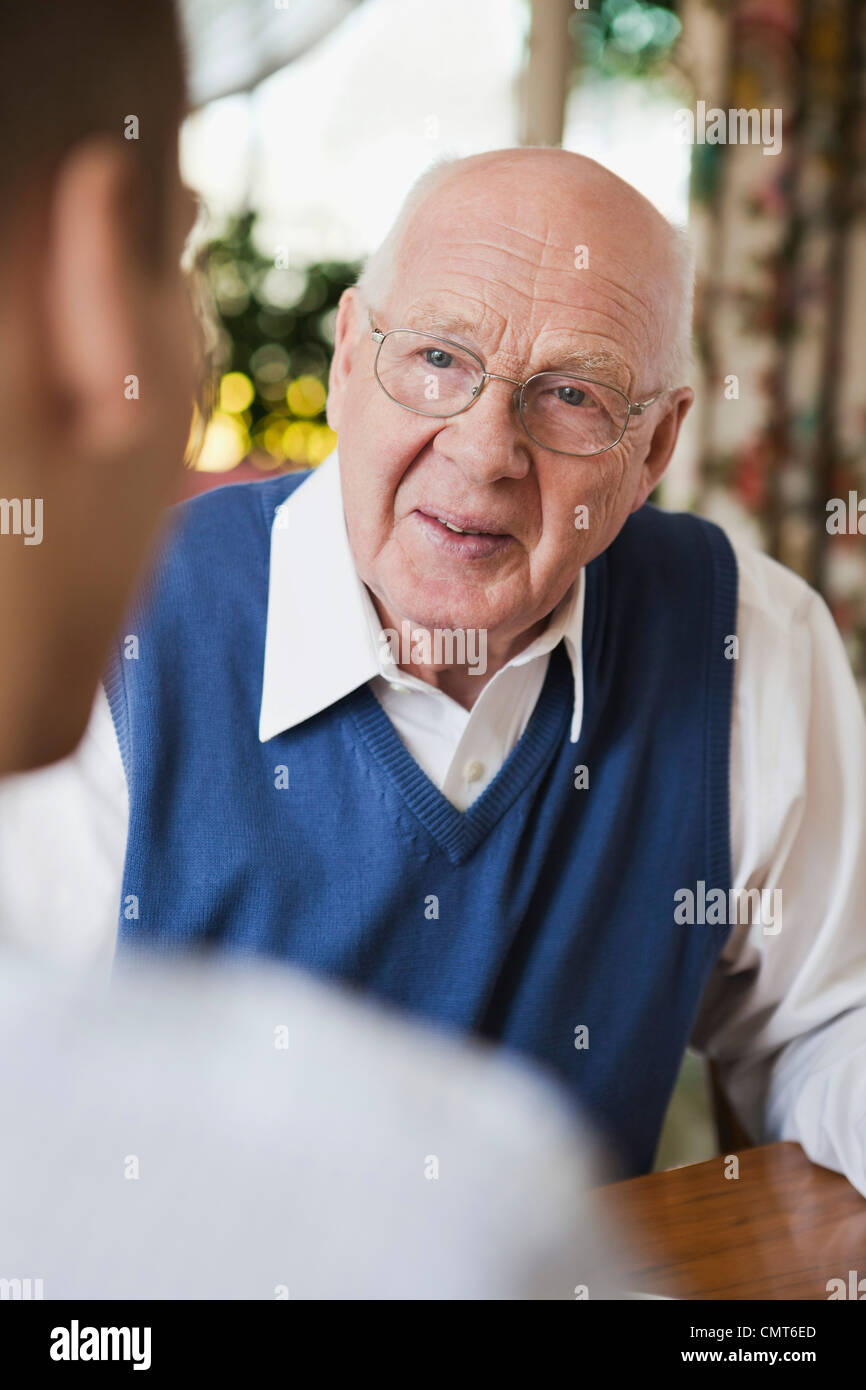 Elderly man in discussion with his son - Stock Image