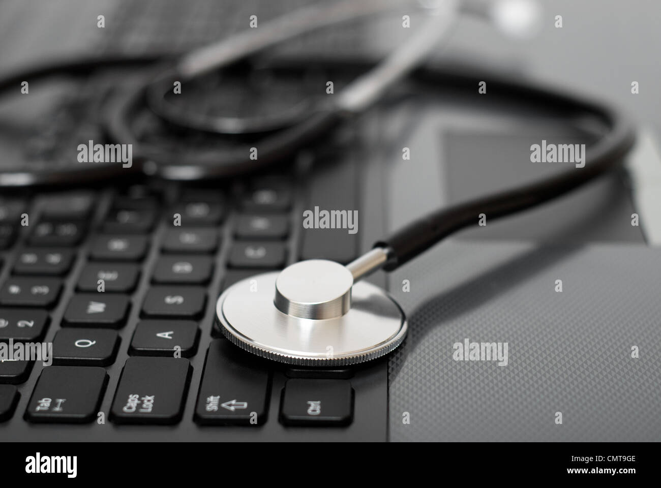 Stethoscope on a computer keyboard - Stock Image