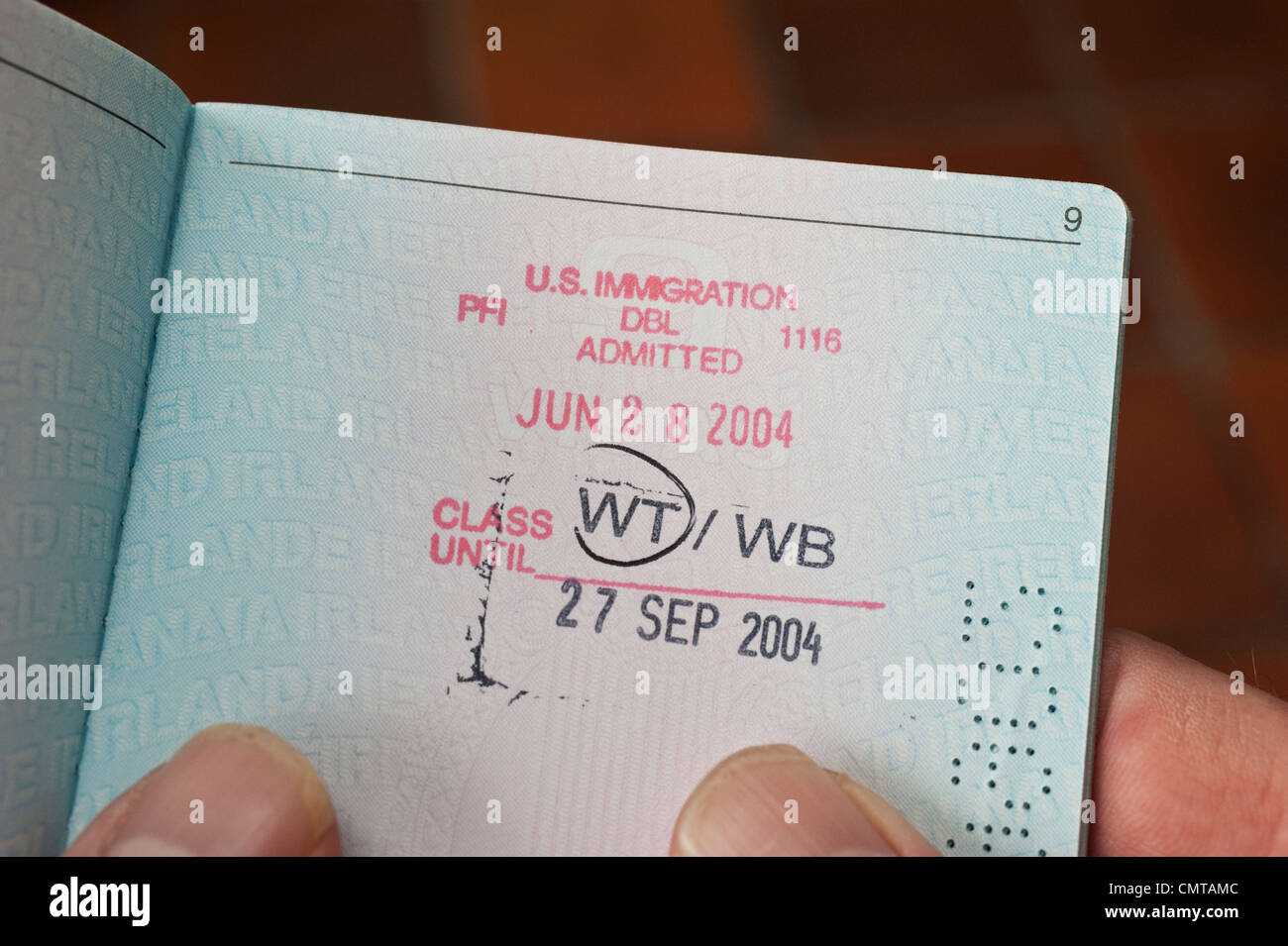 Immigration entry stamps for the United States of America ( USA ) on a passport page - Stock Image