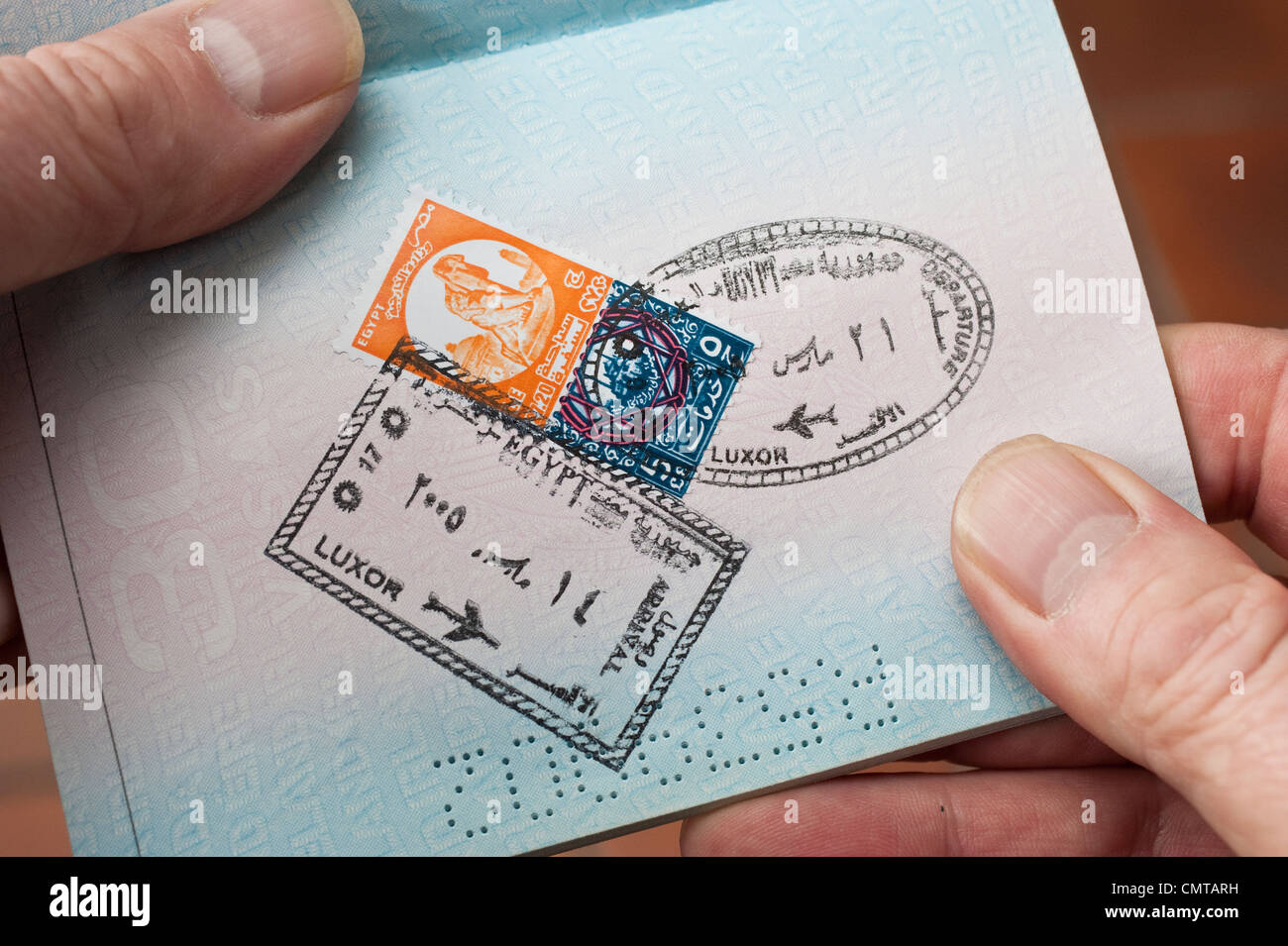 Entry and exit visa stamps for Egypt on a page of a passport - Stock Image