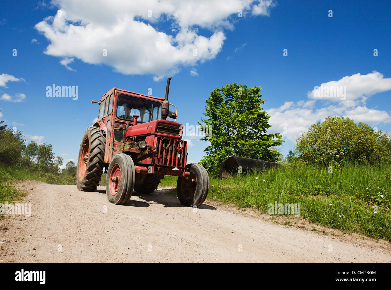 Tractor on country road - Stock Image