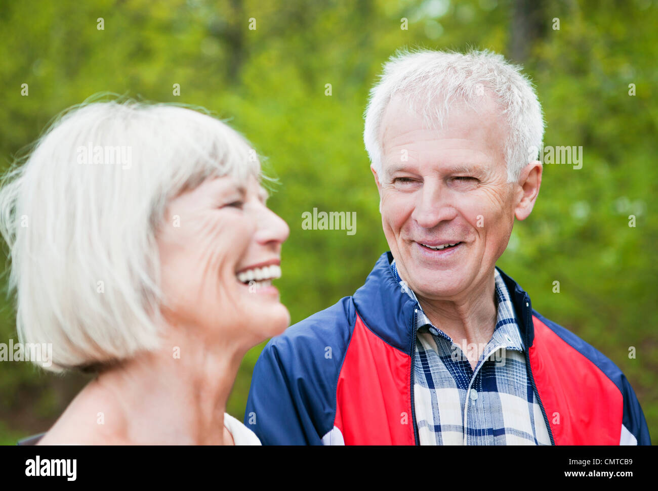 Two smiling senior citizen laughing - Stock Image