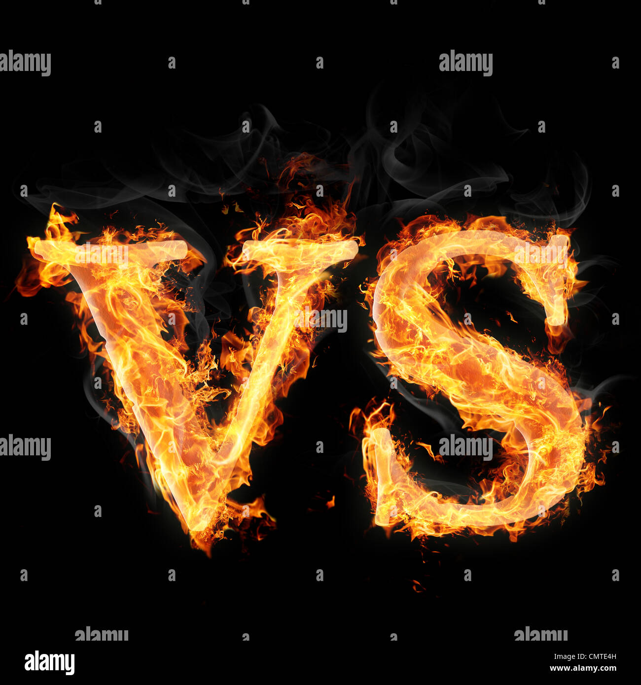 Letters and symbols in fire on black background - Versus - Stock Image