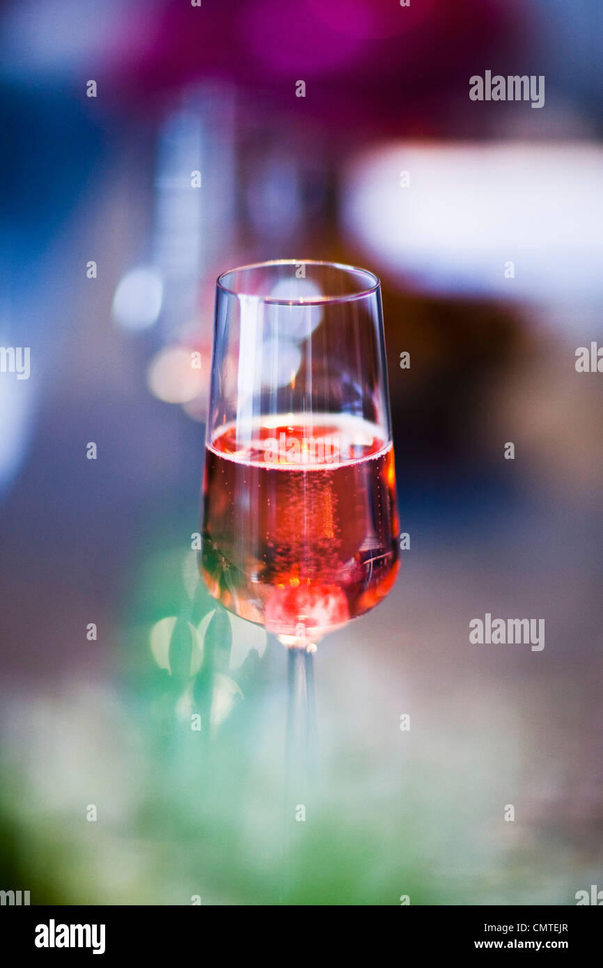 Half-filled glass with drink - Stock Image