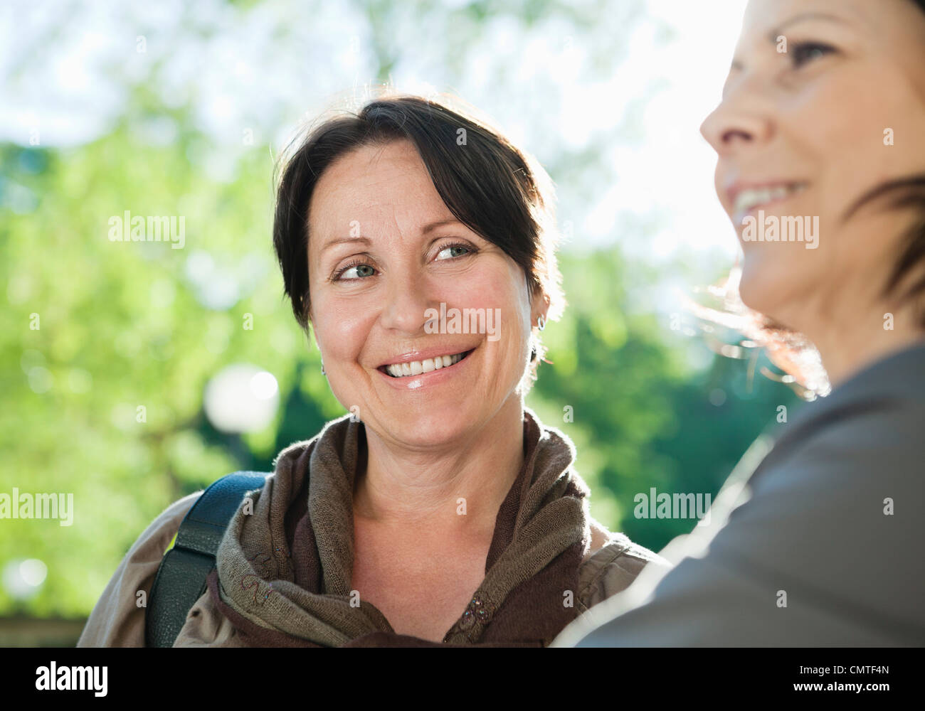 Close-up of coworkers smiling - Stock Image
