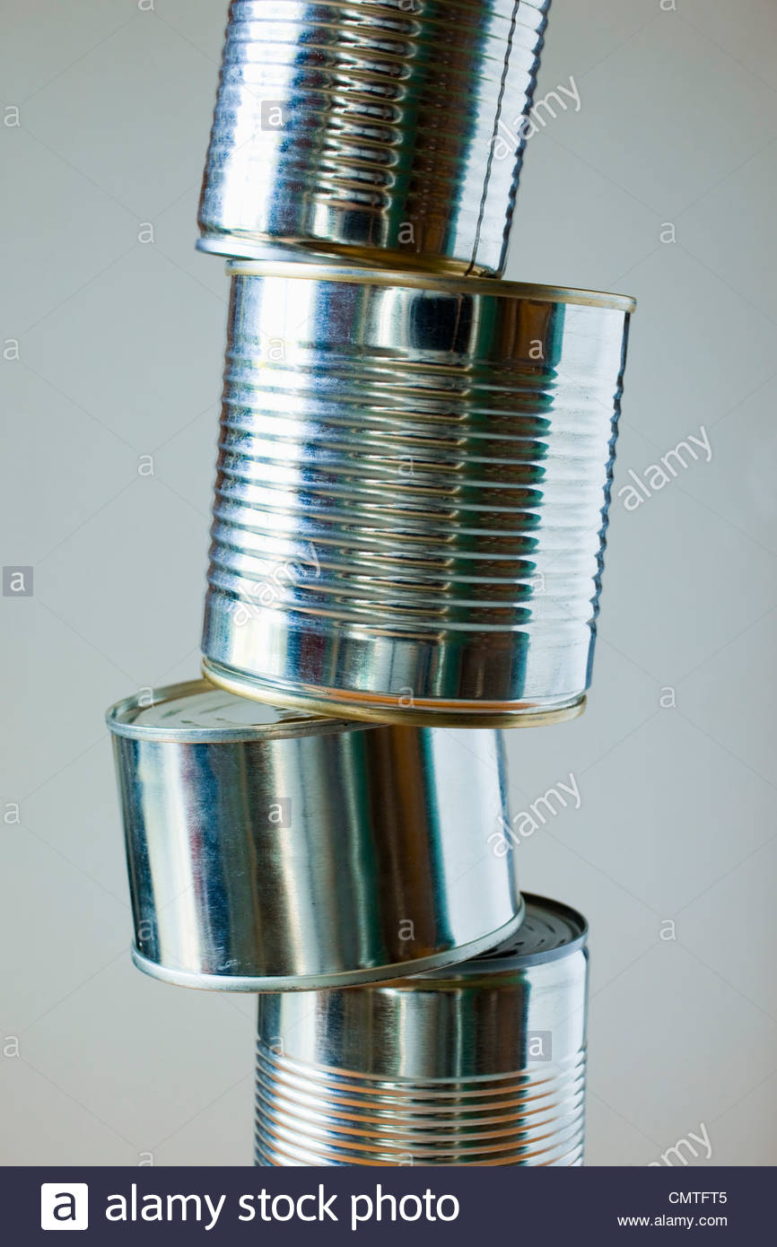 Close-up of stacked cans - Stock Image