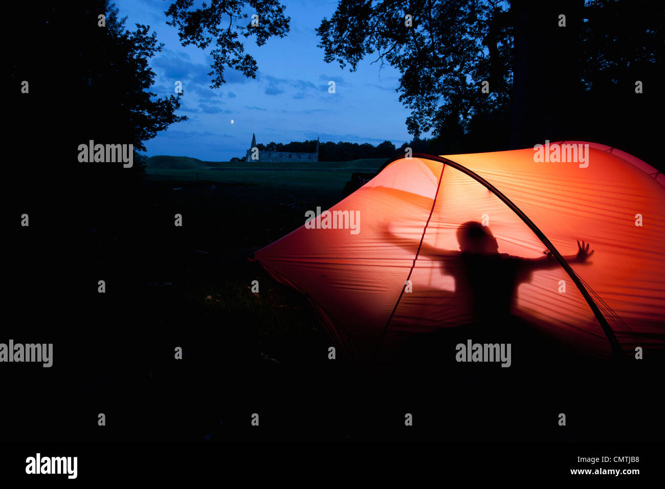 Person in tent - Stock Image