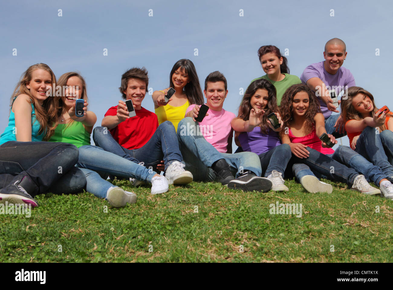 happy group of  teens with cell phones - Stock Image