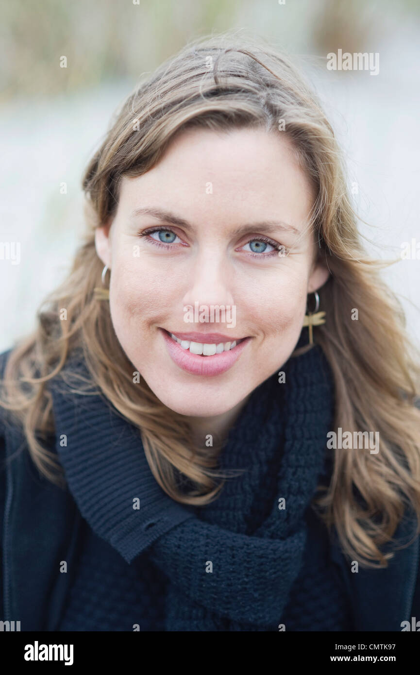 Beautiful woman smiling and looking at camera - Stock Image