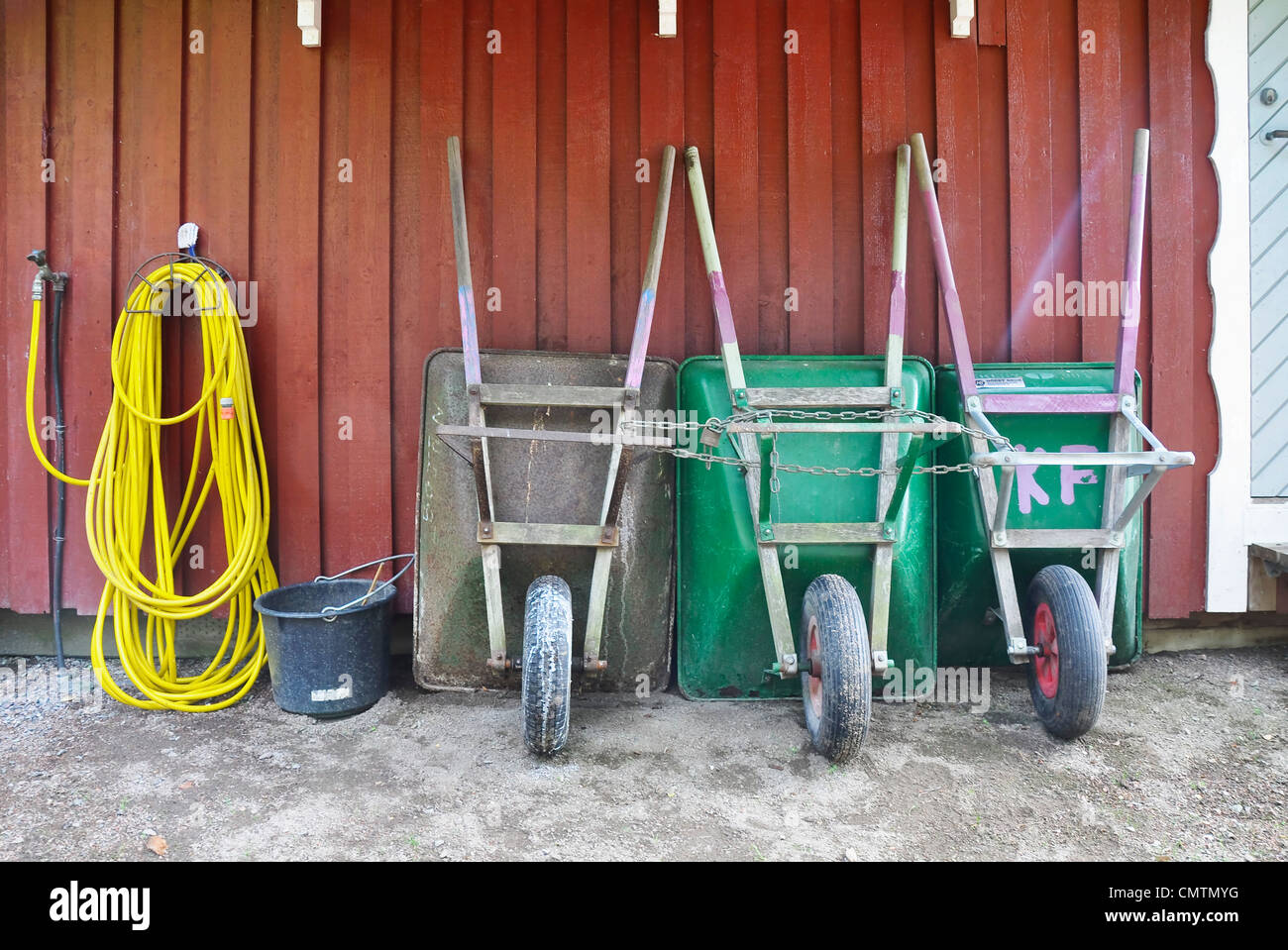Tools side by side against wall - Stock Image