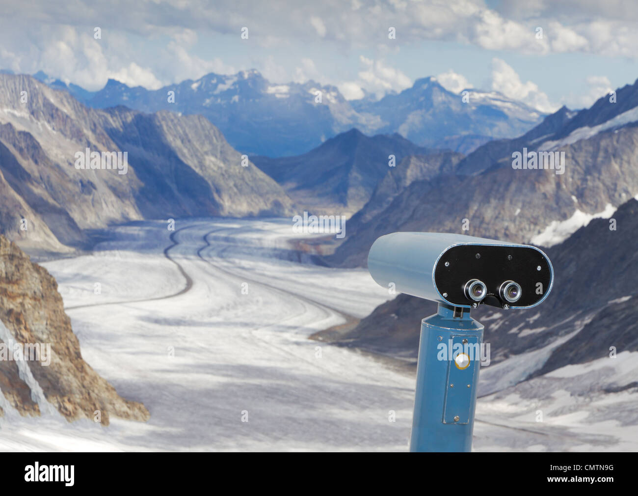 look out, observation and forecast: binoculars view over panorama view above Aletsch glacier starting to disappear - Stock Image