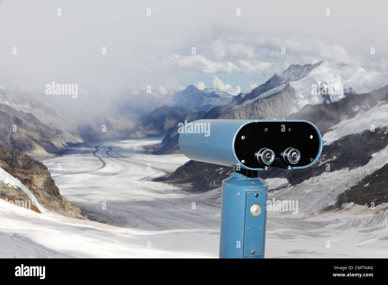 concept for for look out, observation and forecast: binoculars view over panorama view above Aletsch glacier - Stock Image