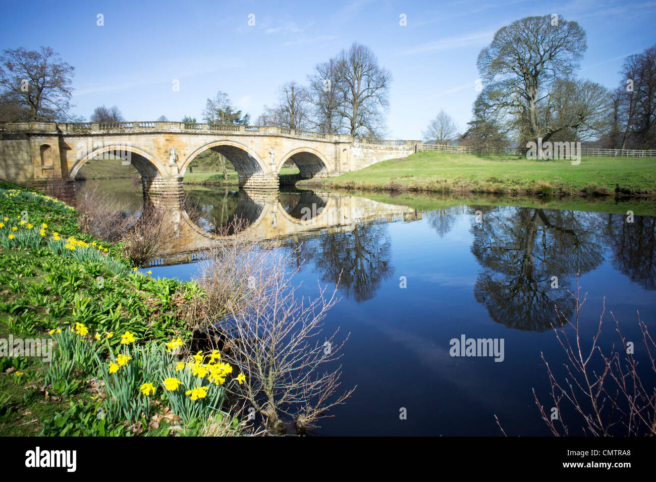River Derwent and bridge in March at Chatsworth House - Stock Image