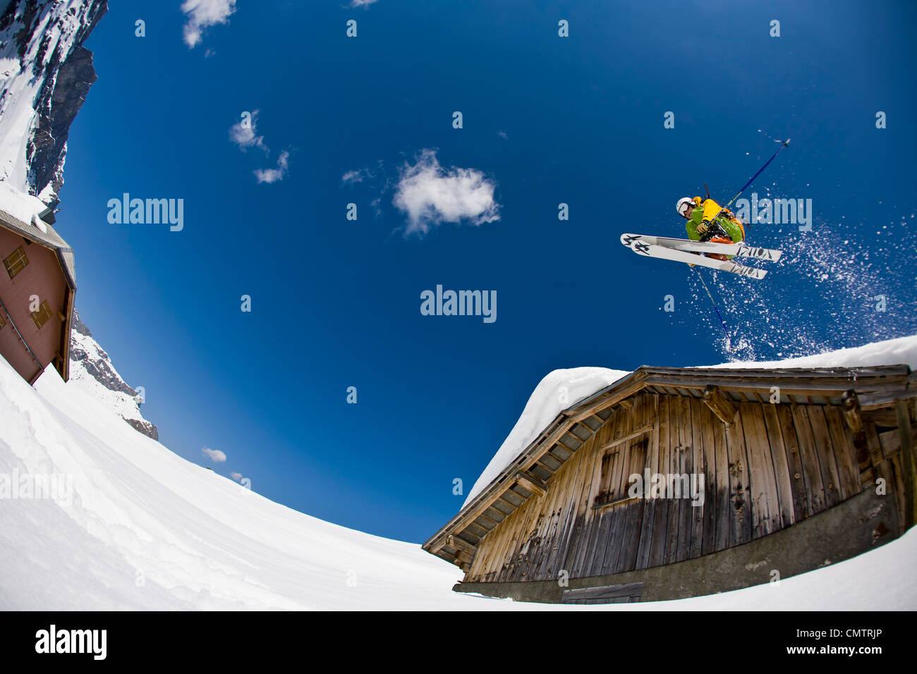 Man jumping with skies - Stock Image