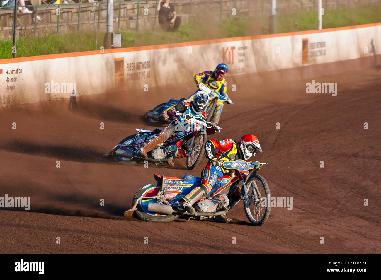 Motorcycle racers taking curve on track - Stock Image