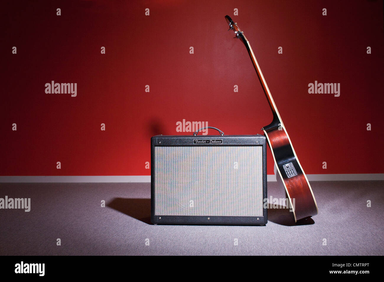 Guitar leaning on amplifier - Stock Image