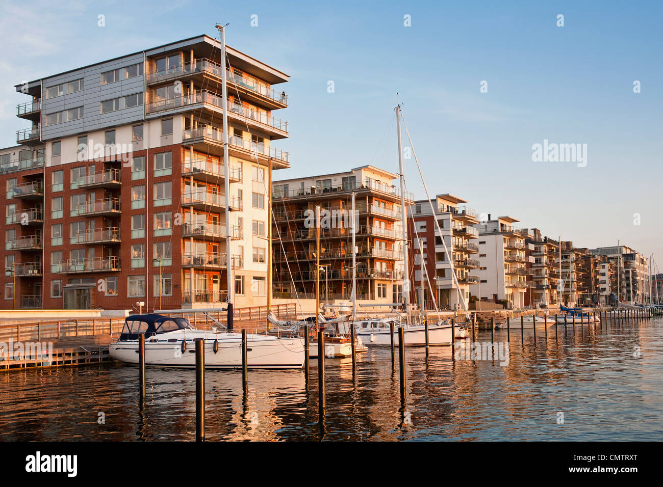 Residential area and nautical vessel against sky - Stock Image