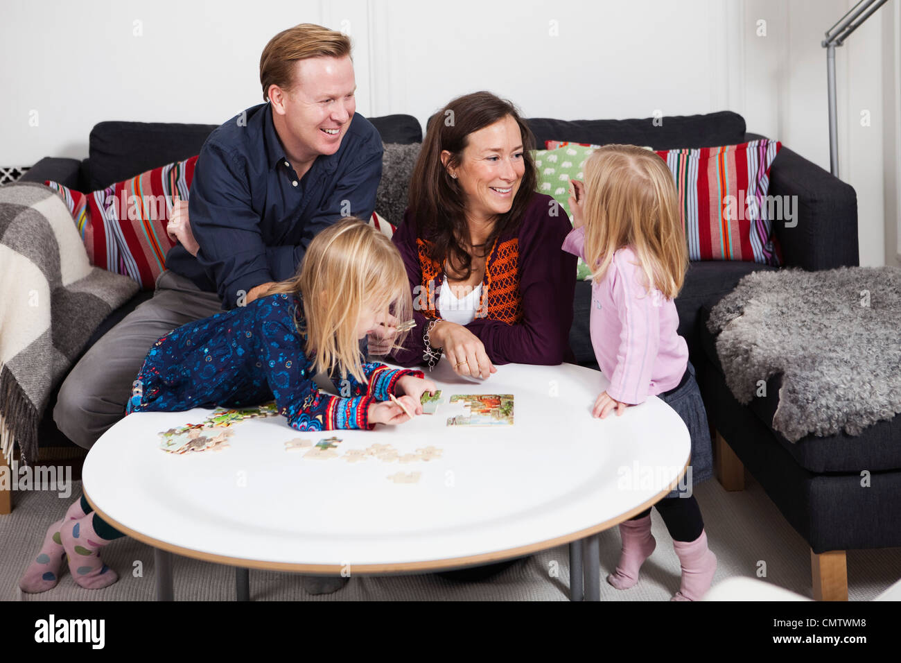 Smiling parents with daughters (2-4) - Stock Image