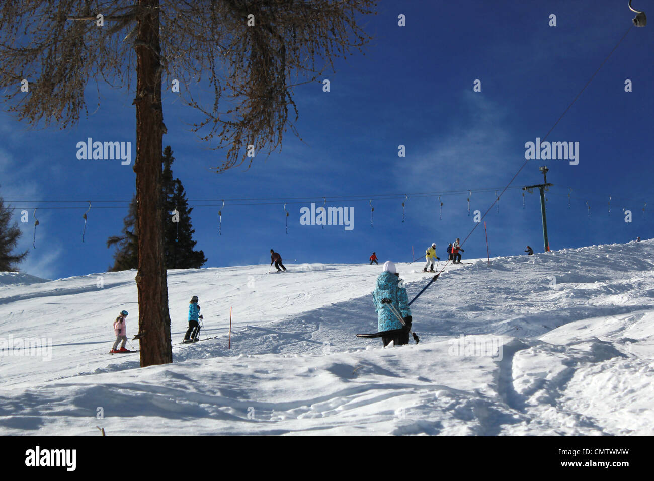 People skiing by beautiful weather in Alps mountain, Switzerland - Stock Image
