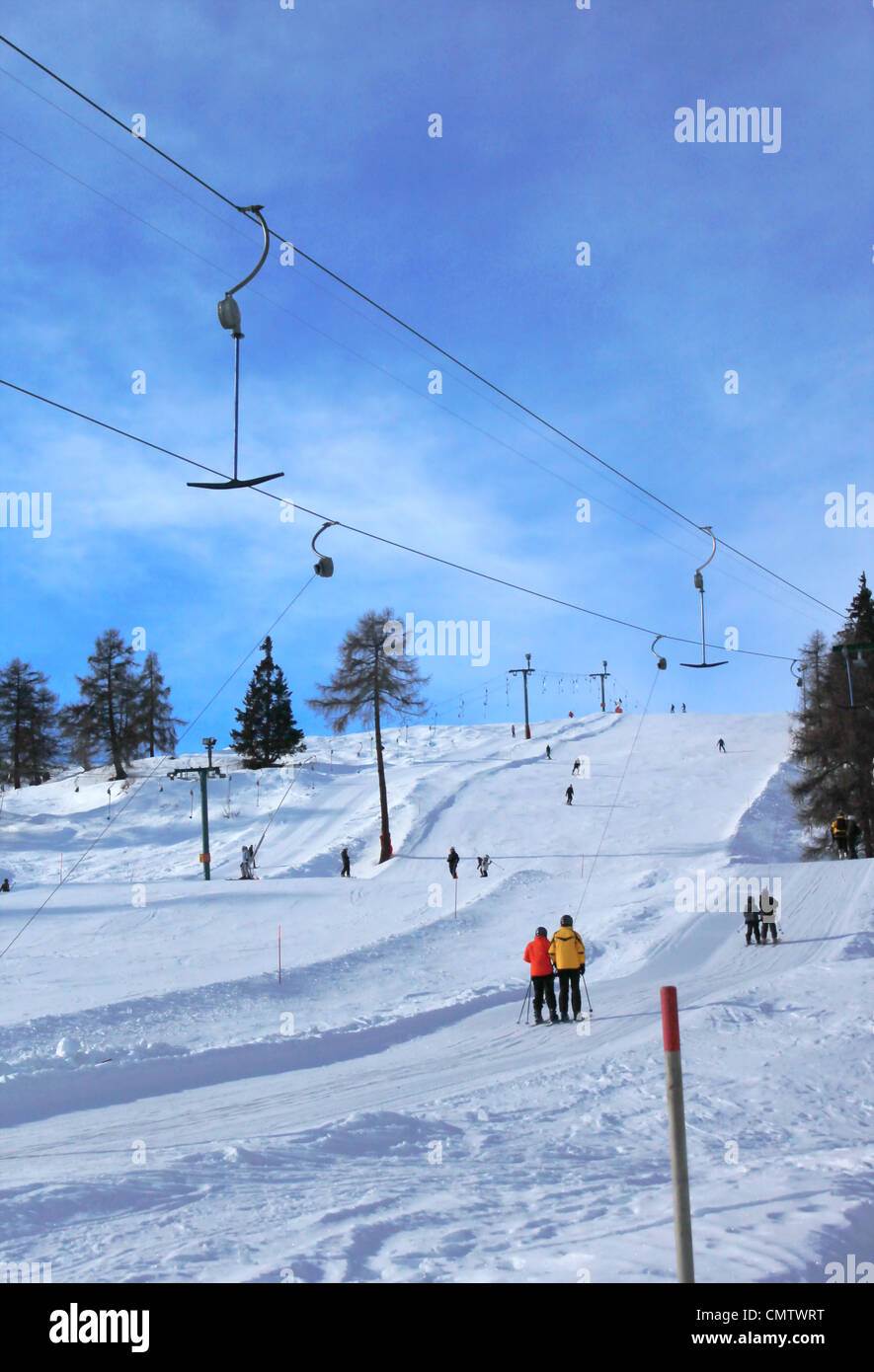 People using ski tow in the winter Alps mountain by beautiful weather, Switzerland - Stock Image