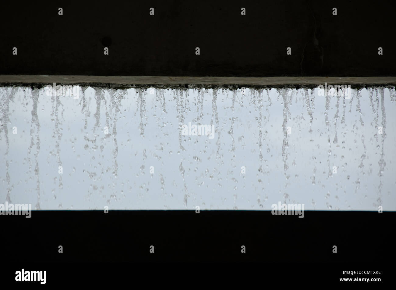 Curtain of water seen from inside a building Stock Photo