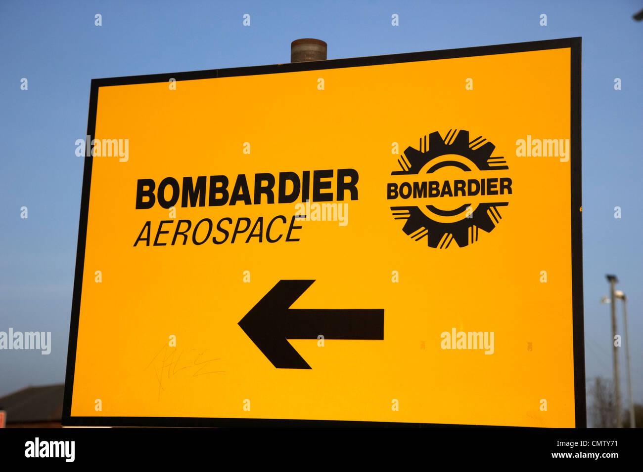 yellow road directions sign for bombardier aerospace belfast, northern ireland uk united kingdom - Stock Image
