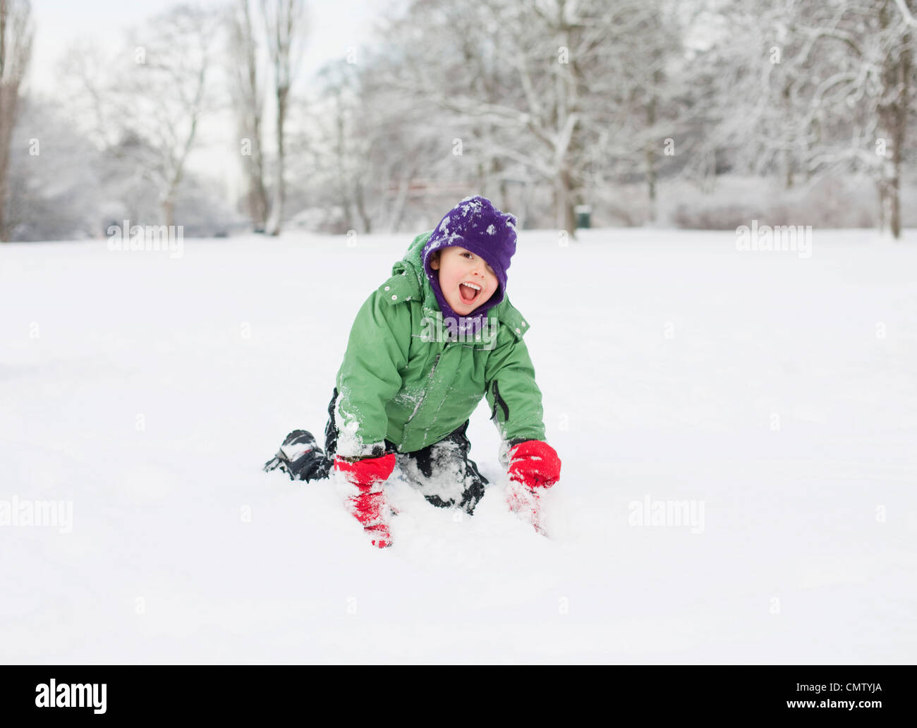 Boy plying in park - Stock Image