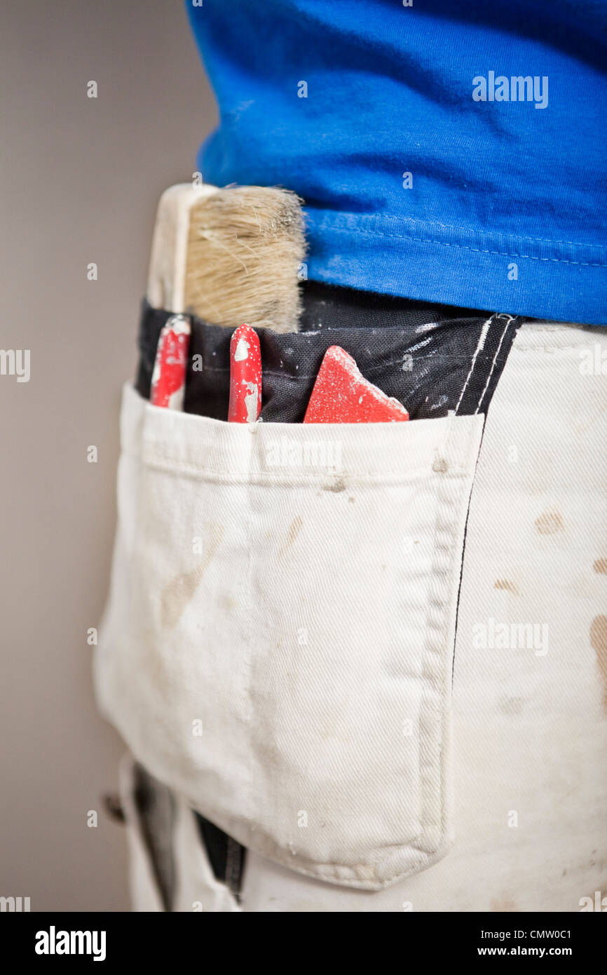 Close-up of tools in man's pocket - Stock Image