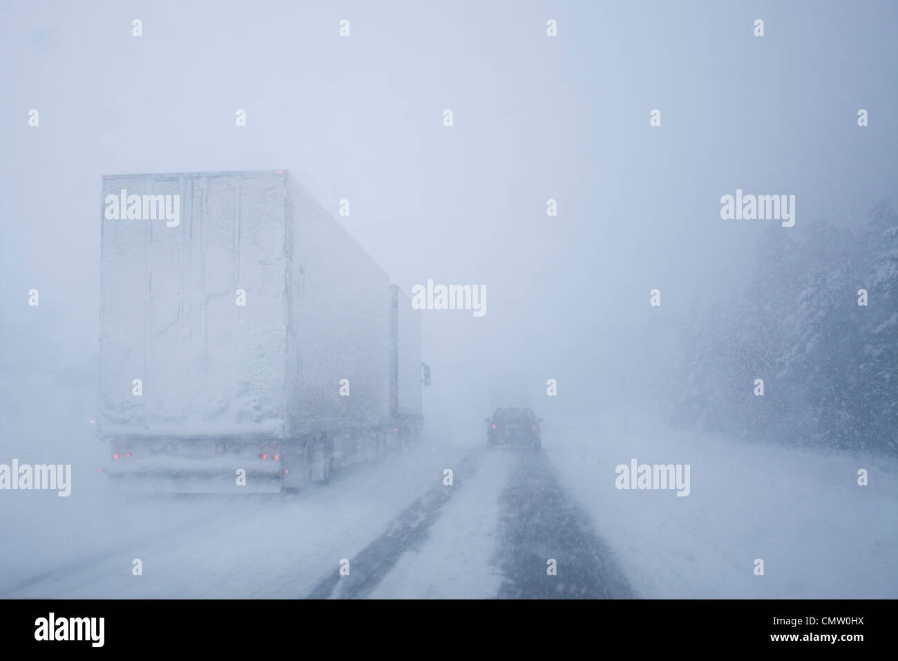 Traffic in snow storm - Stock Image