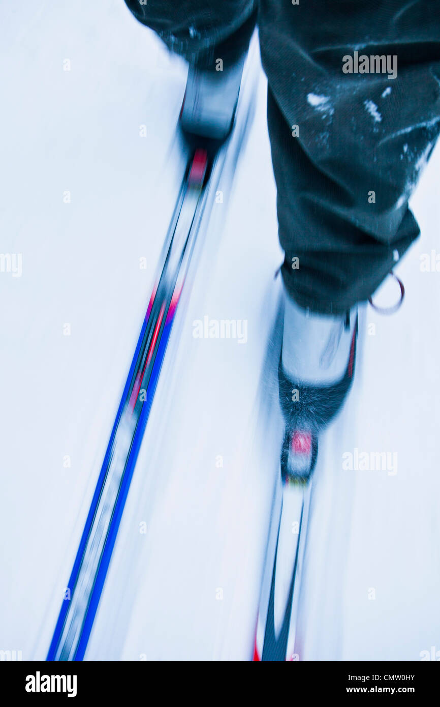 Low section of a person cross-country skiing Stock Photo