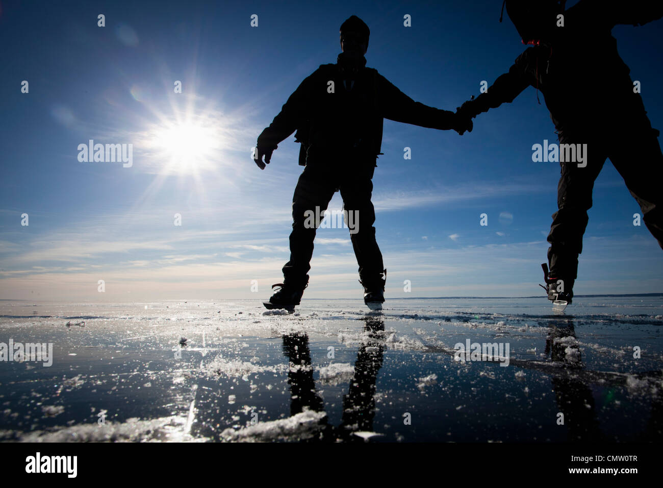 Ice skaters in backlight - Stock Image