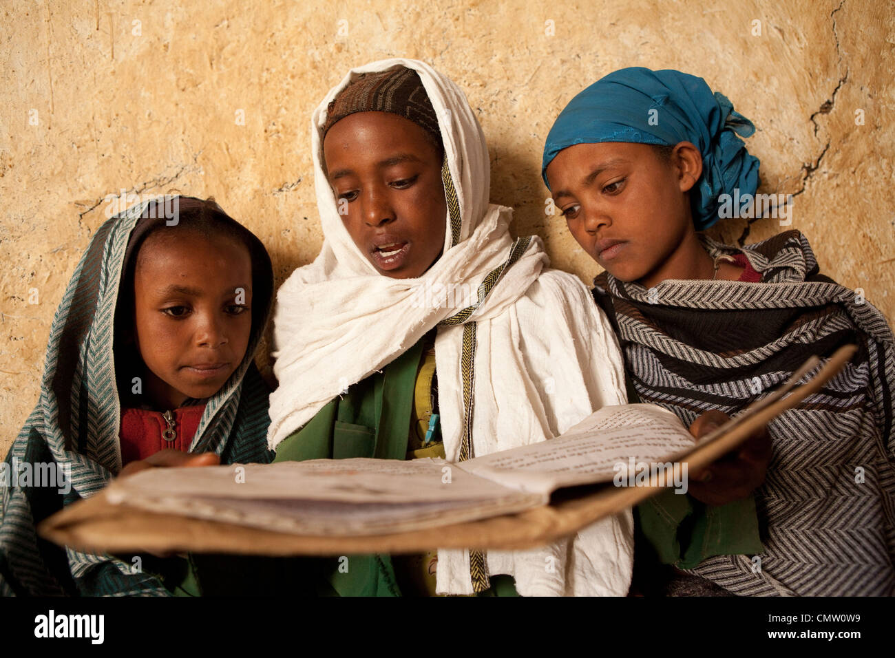 Children read together in Ankober, Ethiopia. - Stock Image