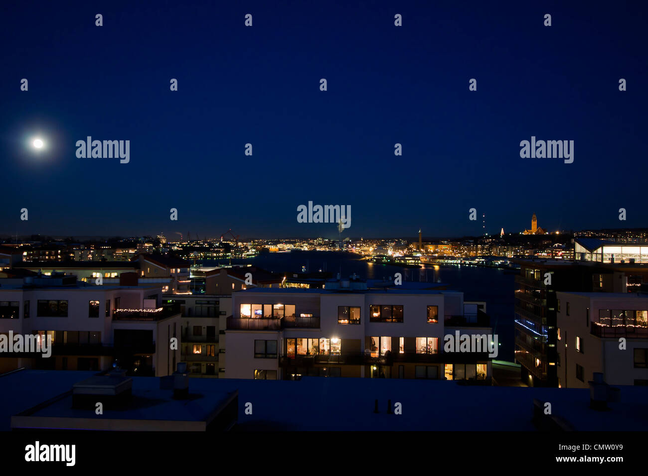 Illuminated view of cityscape at night - Stock Image