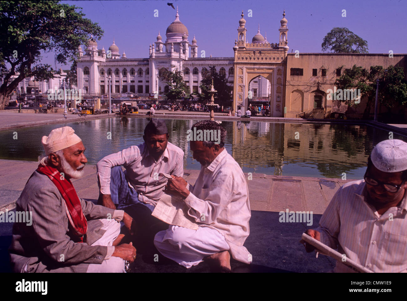 Indian Muslims in mosque courtyard in Hyderabad India - Stock Image