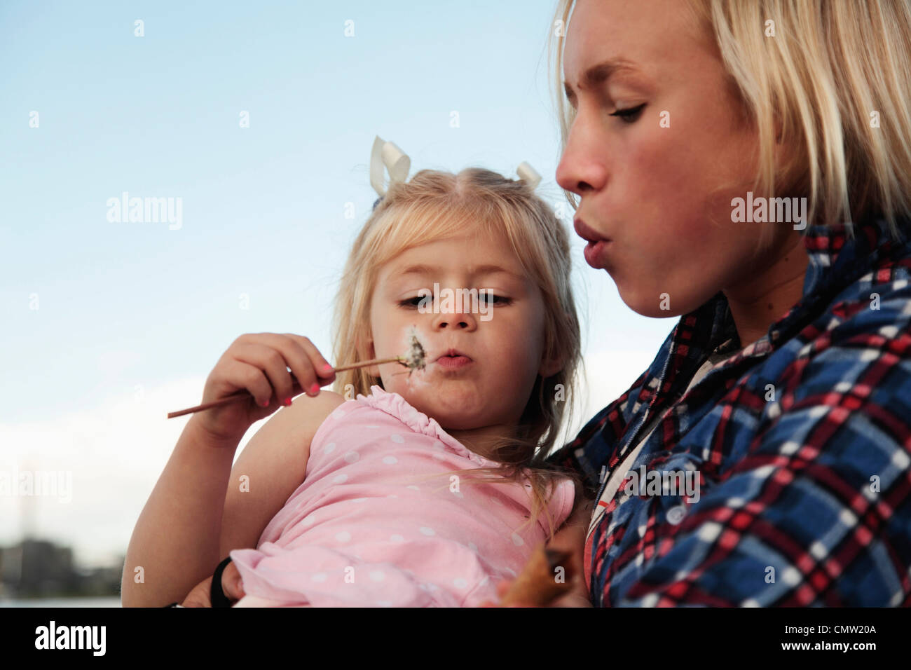 Young girl holds sister - Stock Image