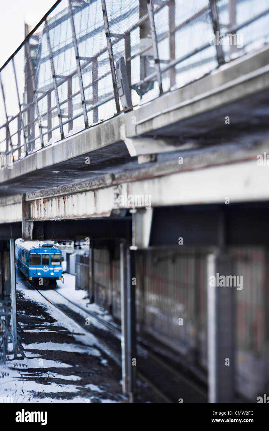 Subway train passing under the bridge - Stock Image