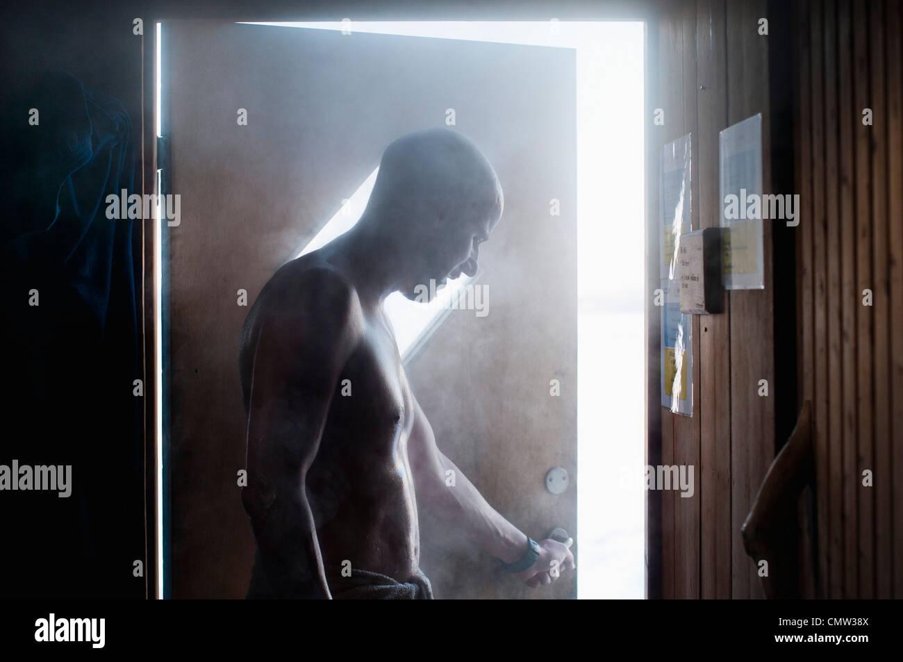 Man entering sauna - Stock Image